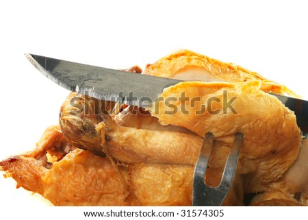 Closeup of carving a roast chicken