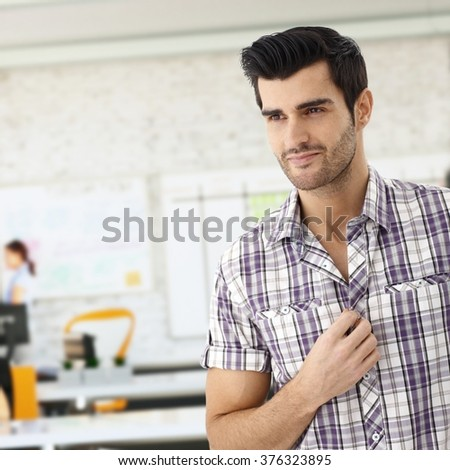 Closeup of casual young caucasian man at office smiling. - stock photo