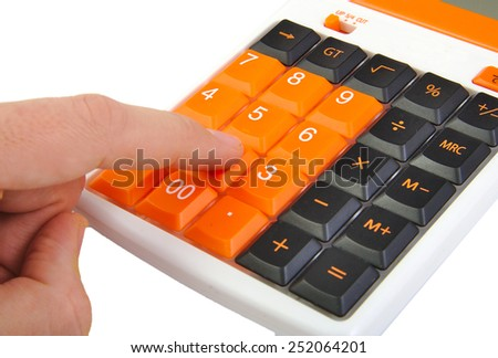 Closeup of caucasian hand using an orange calculator isolated on white background - stock photo