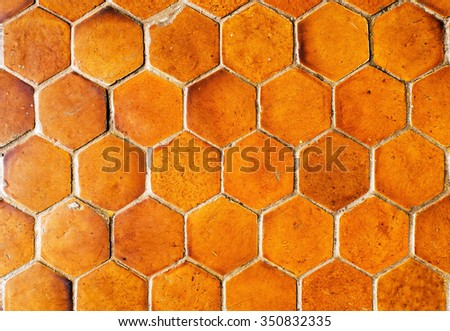Closeup of Cement floor in hexagonal clay tiles  - stock photo