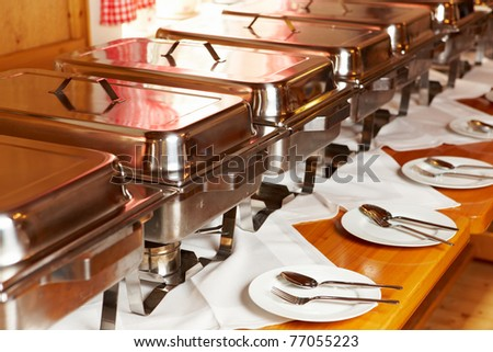 closeup of chafing dishes at a party - stock photo