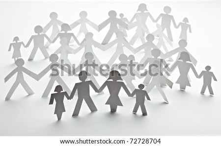 closeup of chain of paper people cut on white background - stock photo