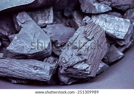 closeup of charcoal in a metal container - stock photo