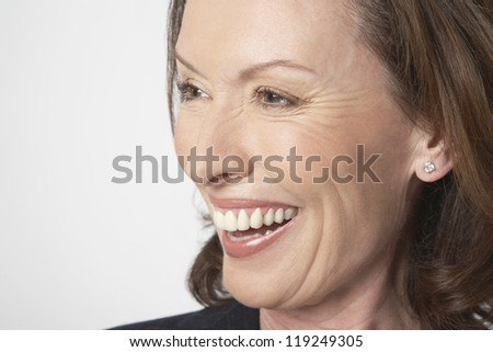 Closeup of cheerful businesswoman isolated on white background