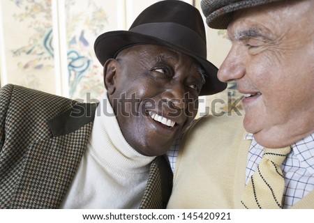 Closeup of cheerful multiethnic senior men smiling - stock photo