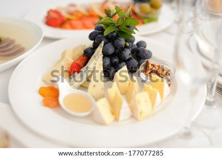 closeup of cheese platter with fruits