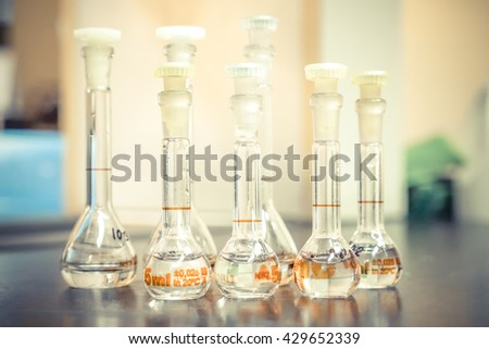 Closeup of chemical bottles on table in laboratory
