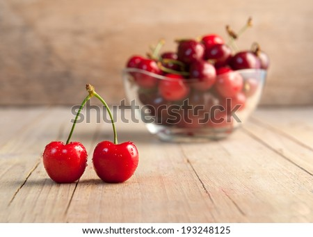 Closeup of cherries joined with blurred background - stock photo