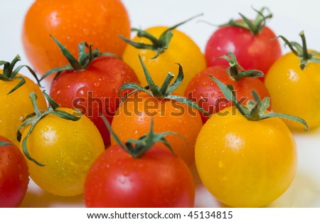 closeup of cherry tomatoes on a white plate - stock photo