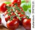 Closeup of cherry tomatoes on the vine - stock photo