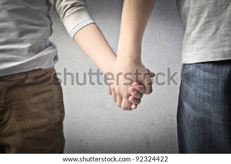 Closeup of children hand in hand