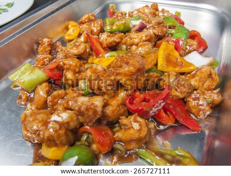 Closeup of chinese prawns in chilli sauce on display at a hotel restaurant buffet - stock photo