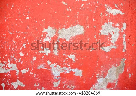 closeup of chipped paint on red wall - stock photo