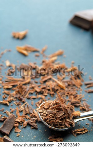 Closeup of chocolate chips on a spoon. Shallow depth of field. - stock photo