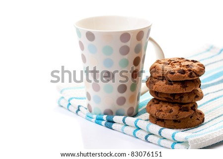 Closeup of chocolate cookies and a cup on white background