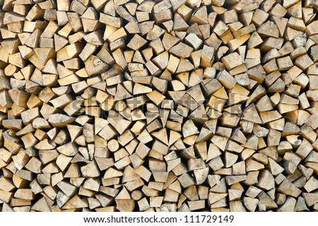 Closeup of chopped firewood logs stacked in a pile