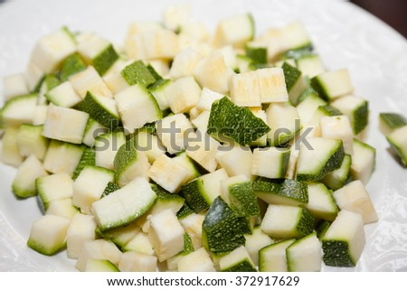 Closeup of chopped zucchini on plate - stock photo