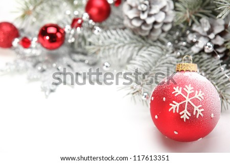 Closeup of Christmas ball with pine branch on abstract background. - stock photo
