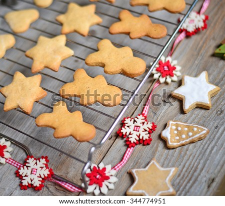 Closeup of Christmas cookies on wooden table with ornaments