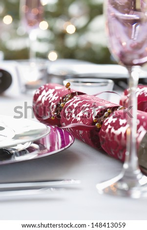 Closeup of Christmas cracker on dining table - stock photo
