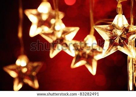 Closeup of Christmas star lights. - stock photo