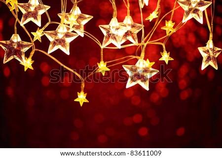 Closeup of Christmas star lights. - stock photo