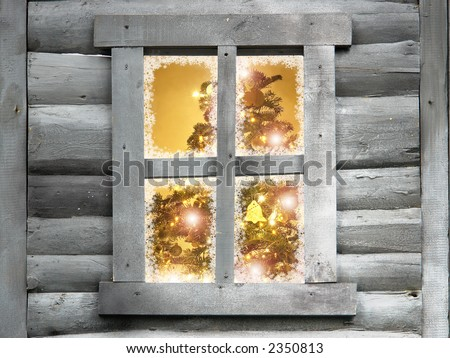 Closeup of christmas tree with lights seen through a wooden cabin window - stock photo
