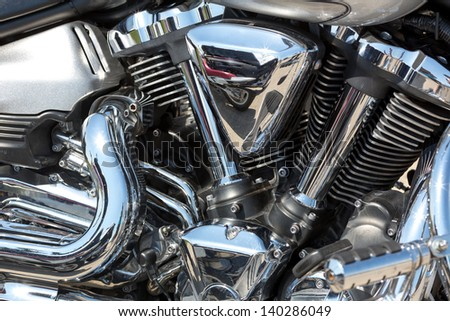 Closeup of chromed motorcycle engine - stock photo