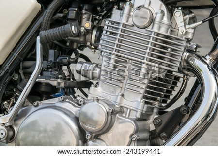 Closeup of chromed motorcycle engine, detail of a classic motorcycle engine - stock photo