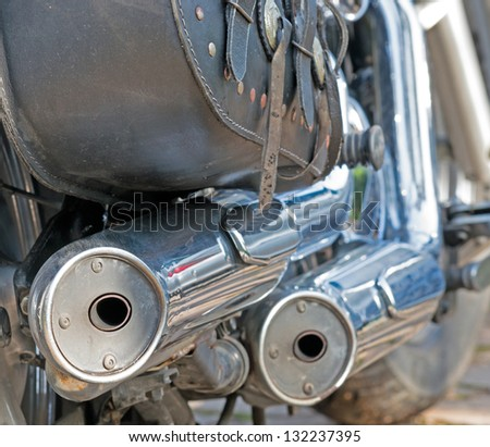 closeup of chromed motorcycle exhaust - stock photo