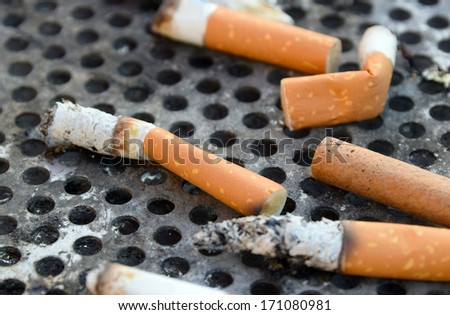 closeup of cigarette butts on a grid