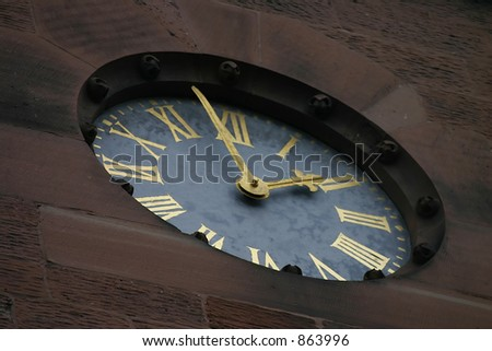 Closeup of Clock on Old Church in Chester England - stock photo