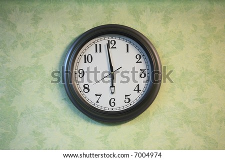 Closeup of clock on the old wall - stock photo