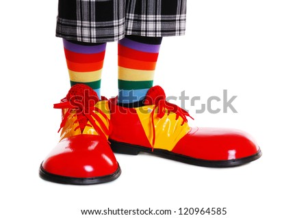 Closeup of clown shoes on white background - stock photo