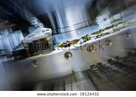 closeup of cnc punching machine with zoom effect - stock photo