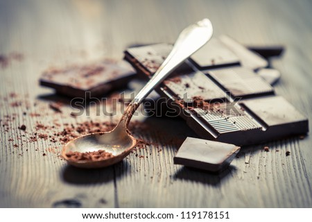 Closeup of Cocoa Powder and Dark Chocolate - stock photo