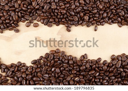 Closeup of coffee beans on wood. Copy space
