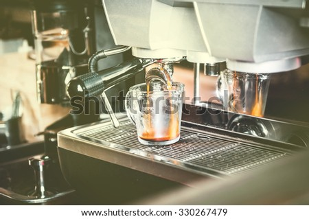 closeup of coffee machine making espresso process