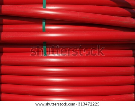 Closeup of Coils of Large Red Hoses - stock photo