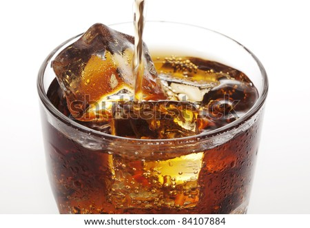 closeup of cola being poured - stock photo