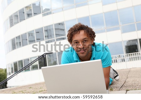 Closeup of college student with laptop computer - stock photo