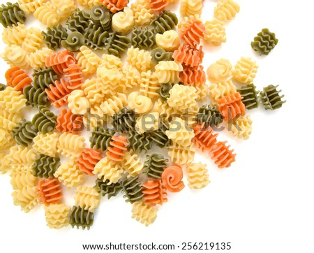 closeup of colored pasta on white background  - stock photo