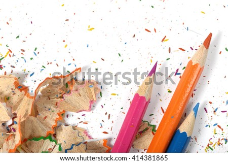 Closeup of colored pencils and its shavings. Workplace of designer. Working material. Sharpening pencils. Willingness to work.  Design scene. - stock photo