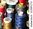 Closeup of colorful cotton reels - stock photo