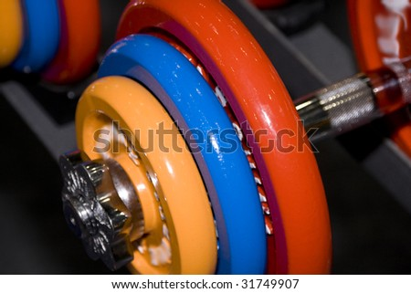 Closeup of colorful dumbbells in a gym or studio - stock photo