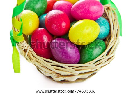 closeup of colorful easter eggs in basket isolated - stock photo