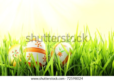 Closeup of Colorful Easter Eggs on Green Grass.