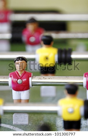 Closeup of colorful foosball mini figurine.