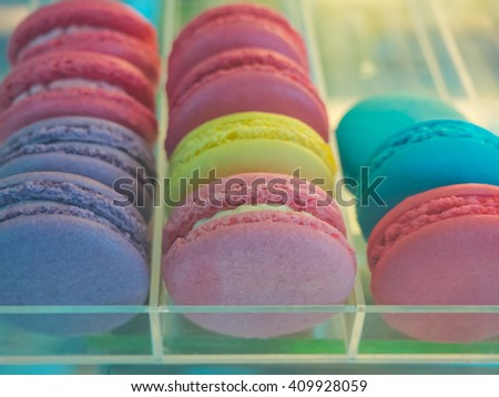 Closeup of colorful French Macaron on plastic tray - stock photo