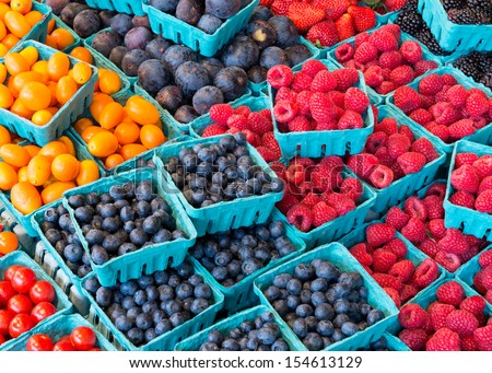 Closeup of colorful fruits at an outdoor market - stock photo